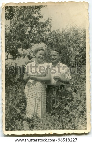 Vintage photo of happy couple outdoor (fifties) - stock photo