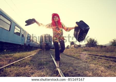 Vintage photo of hippie woman walking on railway barefoot - stock photo