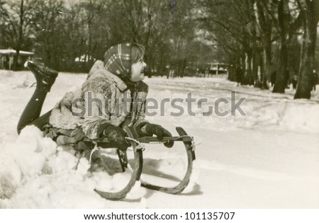 Vintage photo of little girl on sled (fifties) - stock photo