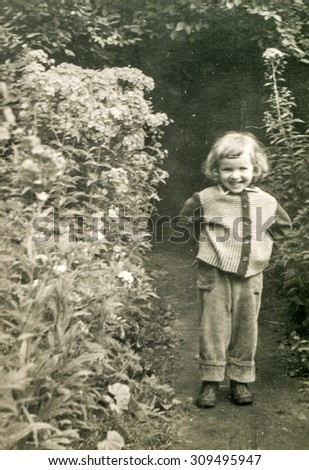 Vintage photo of little girl outdoor, 1950's - stock photo