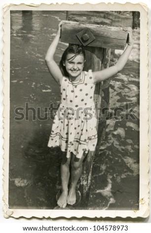 Vintage photo of  little girl (sixties) - stock photo
