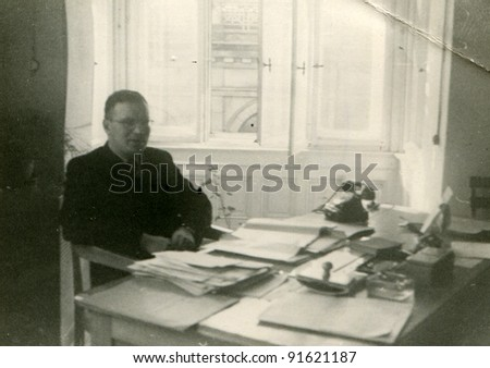 Vintage photo of man in an office (fifties) - stock photo