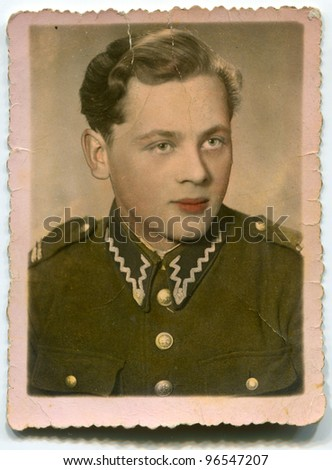 Vintage photo of man in police uniform (artificially colored) - fifties - stock photo