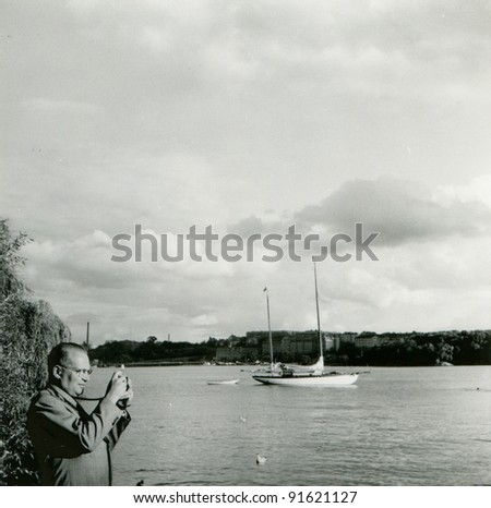 Vintage photo of man photographing (fifties) - stock photo