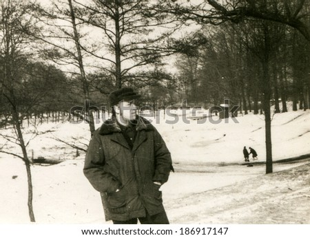 Vintage photo of man walking in park (1970's) - stock photo