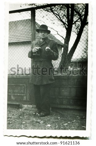 Vintage photo of man with a camera (fifties) - stock photo
