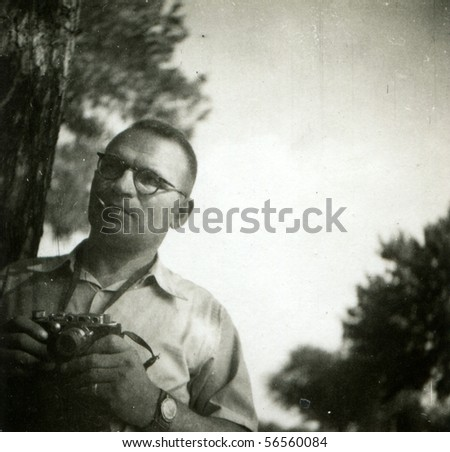 Vintage photo of man with camera (sixties) - stock photo