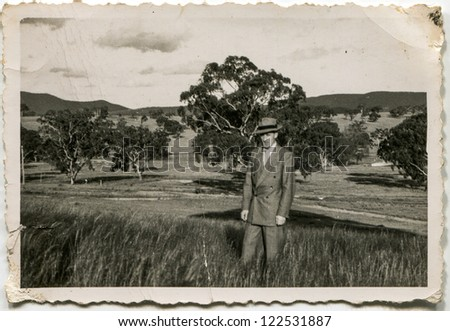 Vintage photo of man with hat outdoor (fifties) - stock photo