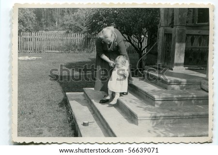 Vintage photo of mother and baby - stock photo