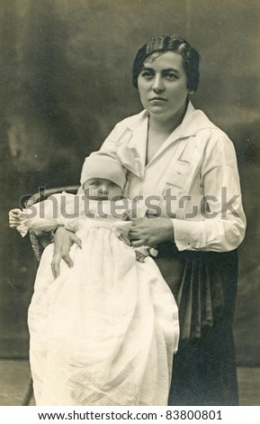 Vintage photo of mother and baby girl (1922) - stock photo