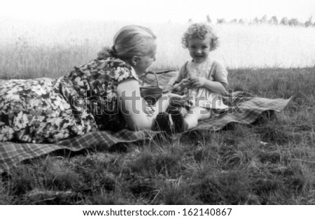 Vintage photo of mother and daughter, fifties - stock photo