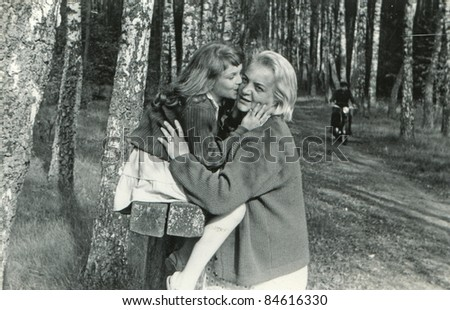 Vintage photo of mother and daughter  (fifties) - stock photo