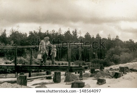 Vintage photo of mother and daughter on bridge (fifties) - stock photo