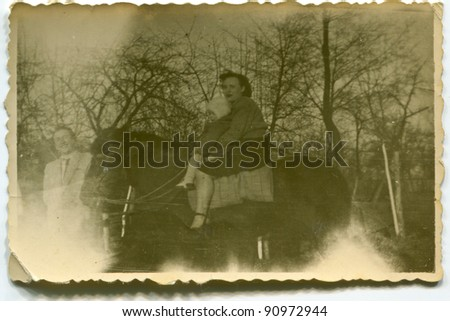 Vintage photo of mother and daughter riding a horse (fifties) - stock photo