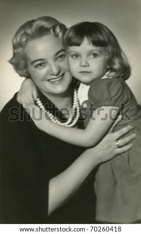 Vintage photo of mother and daughter (visible retouching) - stock photo