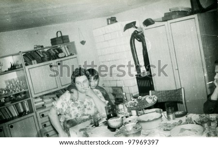 Vintage photo of mother and son during a party (eighties) - stock photo