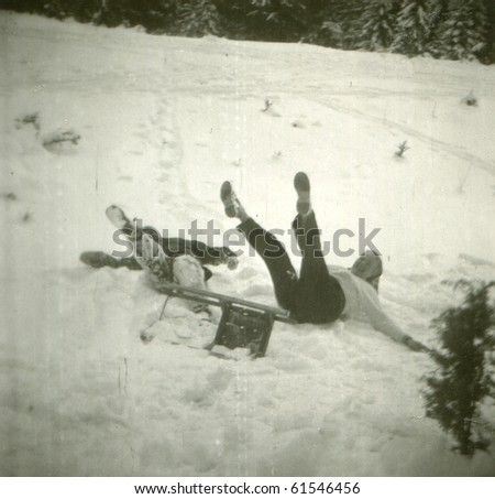 Vintage photo of mother and son during sledding (fifties) - stock photo