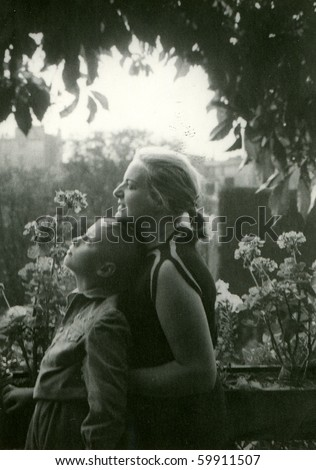 Vintage photo of mother and son (early fifties) - stock photo