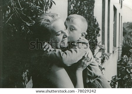 Vintage photo of mother and son (forties) - stock photo