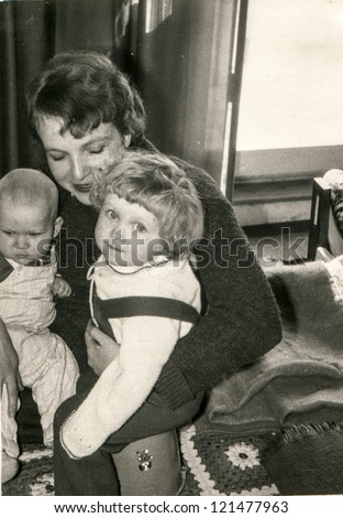 Vintage photo of mother with little children (early eighties) - stock photo