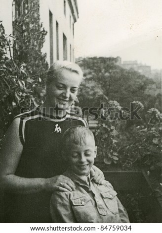 Vintage photo of mother with son (fifties) - stock photo