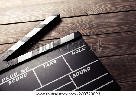vintage photo of movie clapper on wood - stock photo