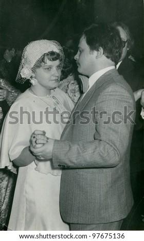 Vintage photo of newlyweds dancing (seventies) - stock photo
