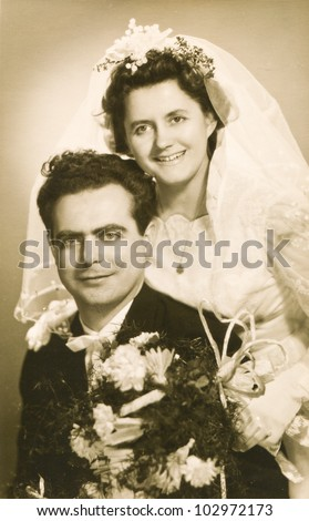 Vintage photo of newlyweds (fifties) - stock photo