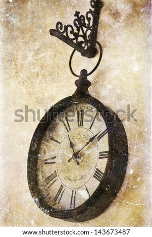Vintage photo of old clock hanging on wall - stock photo