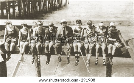 Vintage photo of People Fishing Off A Pier With Homemade Rods - stock photo