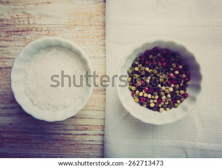 Vintage photo of salt and pepper in white pots - stock photo