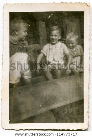 Vintage photo of siblings, fifties - stock photo