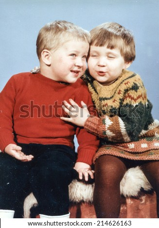 Vintage photo of sister and brother, eighties - stock photo