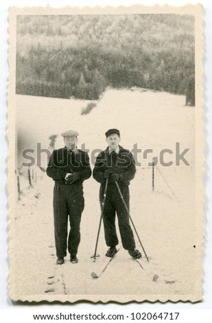 Vintage photo of skier and his friend (fifties) - stock photo