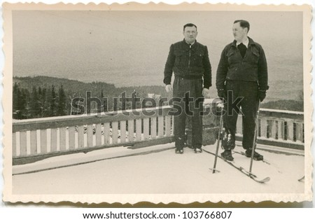 Vintage photo of skier with friend (fifties) - stock photo