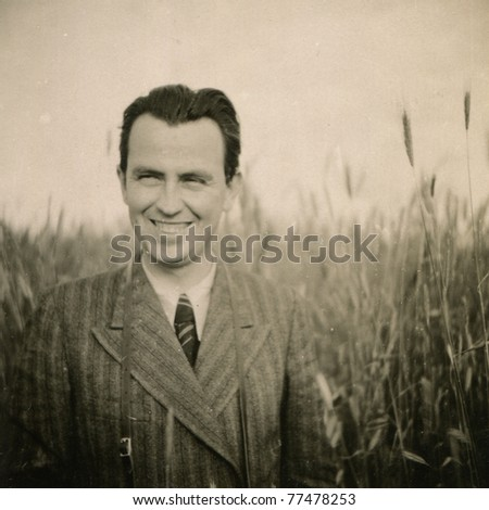 Vintage photo of smiling man (forties) - stock photo