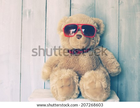Vintage photo of Teddy bear toy - stock photo