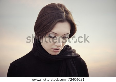 Vintage photo of the sad lady with black belcher at the sunset background - stock photo