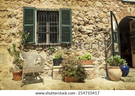 Vintage photo of traditional house in mediterranean village in Mallorca, Spain - stock photo