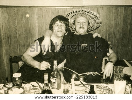 Vintage photo of two brothers in costumes during a fancy dress party, early eighties - stock photo