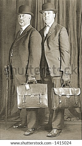 Vintage photo of Two Businessmen With Briefcases - stock photo