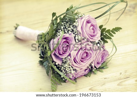 Vintage photo of wedding bouquet of pink roses - stock photo