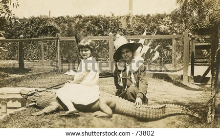 Vintage photo of woman and girl riding an alligator - stock photo