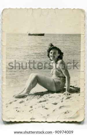 Vintage photo of woman on beach (fifties) - stock photo