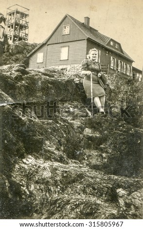 Vintage photo of woman outdoor, 1950's - stock photo