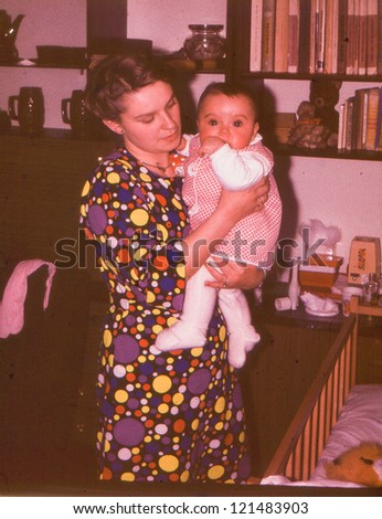 Vintage photo of young aunt with her niece (early seventies) - stock photo