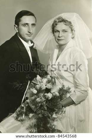Vintage photo of young couple (fifties) - stock photo