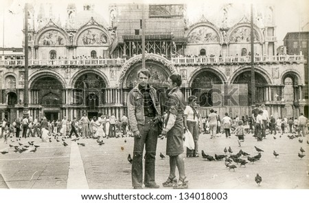 Vintage photo of young couple in honeymoon trip to Venice, seventies - stock photo