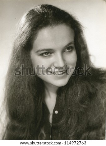 Vintage photo of young girl (early seventies) - stock photo