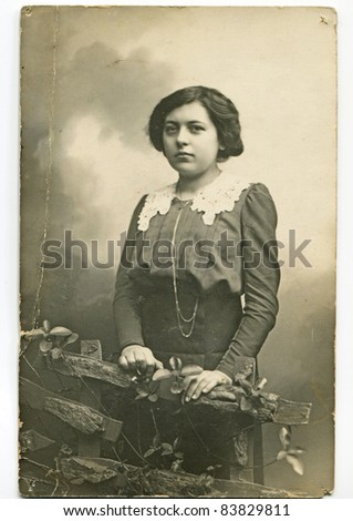 Vintage photo of young woman (1914) - stock photo
